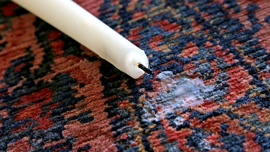 روش پاک کردن لکه شمع روی فرش